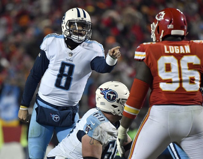 Former Tennessee Titans quarterback Marcus Mariota (left) calls a play at the line of scrimmage during the second half of an NFL wild-card playoff football game against Kansas City Chiefs, in Kansas City, Mo., Jan. 6, 2018. Could the Pats be in on bringing in Mariota at quarterback?