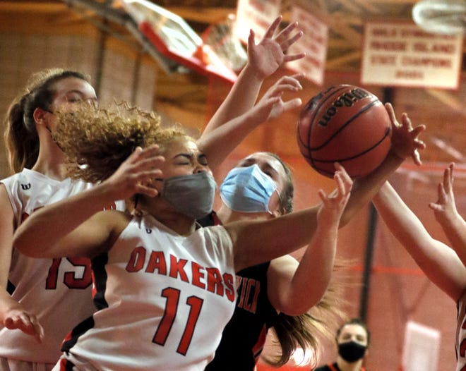 Coventry's Anayah Melgar worked hard to get this rebound Monday night, but West Warwick got the job done everywhere else in a 45-32 non-league win.