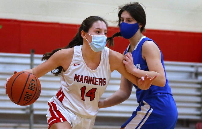Narragansett, RI, Feb 9, 2021 - The Mariners' Leah Hart moves around Ashley Ney of the Islanders on the way to the hoop Tuesday afternoon.  The Narragansett Mariners girls basketball team beats Middletown's Islanders 48-28 at home on Tuesday afternoon.  [The Providence Journal / Kris Craig]
