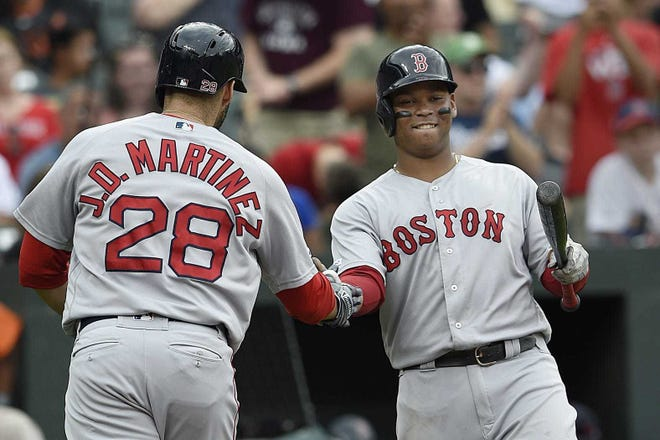 J.D. Martinez and Rafael Devers both struggled in the COVID-shortened 2020 season and any improvement the Red Sox hope to see next year will depend on them returning to form. [AP, file / Gail Burton]