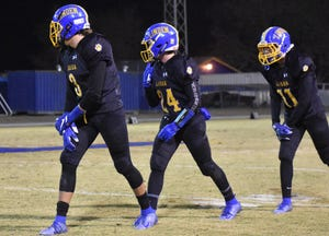 Linden senior receiver Tyler Rathjen (8) lines up wide in a formation along with teammates Brock Lund (24) and Matthew Kafton (11) in their game against Highlands at Linden High School in November 2019.