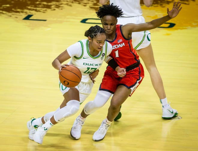 Oregon's Te-Hina Paopao (12) drives on Arizona guard Shaina Pellington during their Feb. 8 game at Matthew Knight Arena. Paopao and the Ducks host Stanford on Monday.