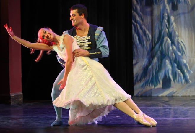 "In this December 2009 file photo from The Record, Claudia Weeks as Clara dances with Luis Abella as the transformed Nutcracker in the kingdom of snow during the St. Augustine Community ""Nutcracker"" at Flagler College's Lewis Auditorium."