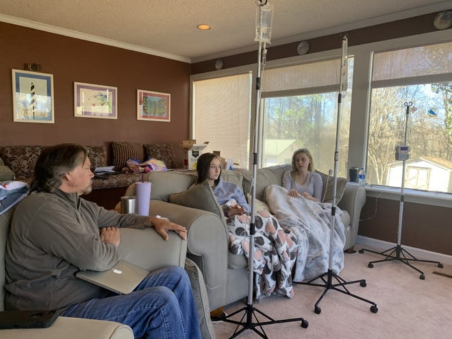 Mark Folk talks to his daughters, Sydnee Folk and Madison Hartman, as they receive treatment for gastrointestinal disorders. They shared their story of battling ulcerative colitis and Crohn's Disease together.