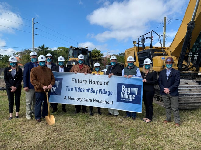 Executives and board members of Bay Village and representatives of ME&S General Contractors appear at the groundbreaking for The Tides of Bay Village on Feb. 2.