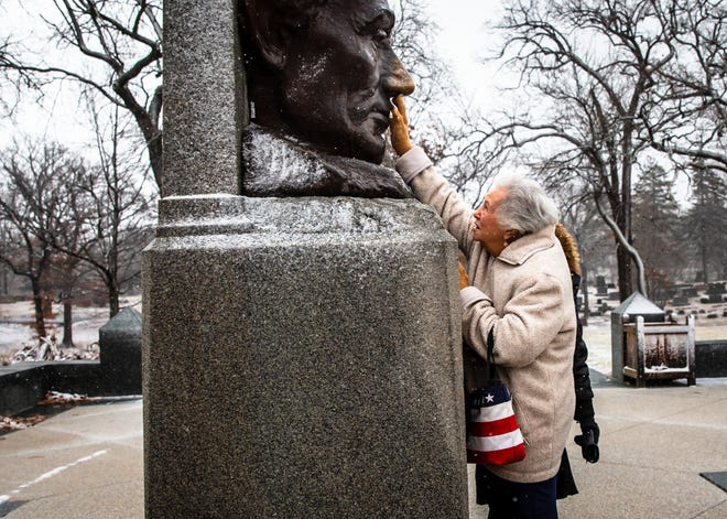 """Virginia Ball, of El Dorado, Kansas, gets a bit of good luck from the nose of Abraham Lincoln as she visits the Lincoln Tomb State Historic Site for the first time with American Legion Post 81 during the 85th annual American Legion Pilgrimage to Lincoln's Tomb, Tuesday, Feb. 12, 2019, in Springfield, Ill. """"I want my family to come back, there is so much to learn from here,"""" said Ball of visiting the site for the first time. """"It's wonderful and I want to come back, but I'm 93 so I hope get to."""" [Justin L. Fowler/The State Journal-Register]"""