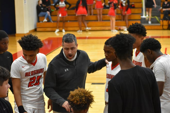 Bryan County boys basketball coach Brent Anderson talks to his players during a regular-season game.