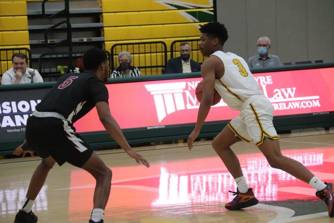OBU's Jaquan Simms (3) looks to drive the basketball against Southern Nazarene earlier this season. The Bison played SNU again Monday and came away with a 60-57 come-from-behind win. Simms tallied 19 points for OBU.