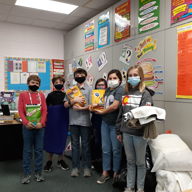 Local Parrott fourth graders help stock donated blankets and pet food for the SPCA: (left to right) Hardy Meadows, Gray Wheeler, Reed Hodges, Londyn Vick, Delaynie Anderson, and Nora Carpenter. Not pictured, Hanes Jessup, Gretchen Jessup, and Benjamin Howard. [CONTRIBUTED PHOTO]