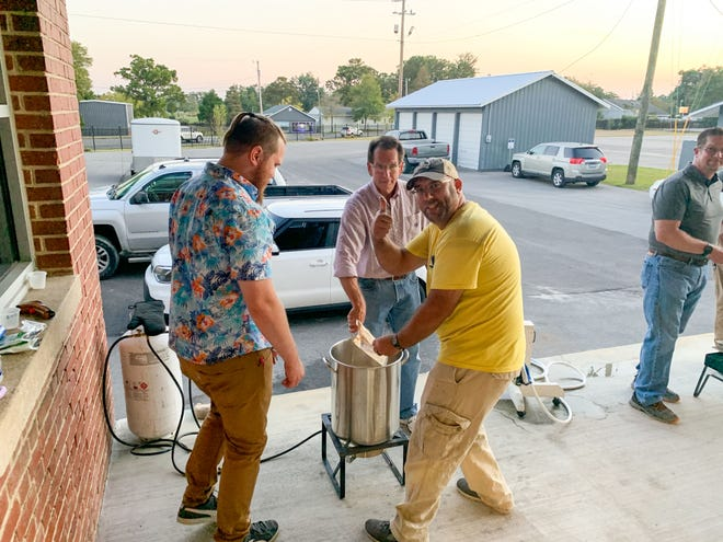Students in Craven CC's Introduction to Homebrewing class enjoy brewing beer as the sun sets. The next class will begin Feb. 18 at the Volt Center. [CONTRIBUTED PHOTO]