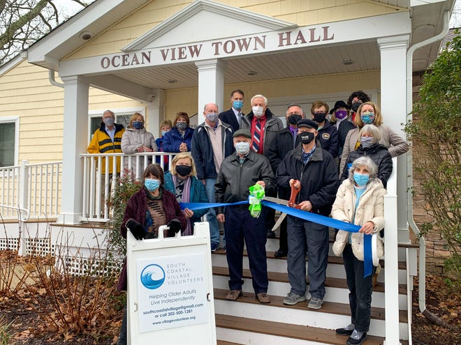 The Bethany-Fenwick Area Chamber of Commerce helped South Coastal Village Volunteers celebrate the grand opening of its Ocean View office with a ribbon-cutting ceremony Jan. 26, with local officials joining the chamber's steering committee.