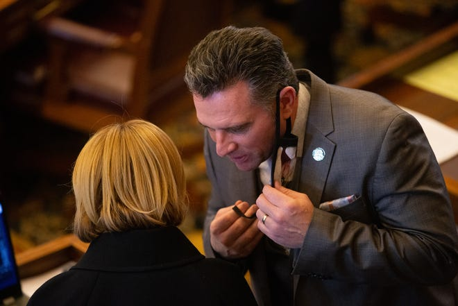 Sen. Caryn Tyson, R-Parker, speaks with senate president Ty Masterson, R-Andover, right. Masterson is personally backing a bill requiring schools to offer in-person learning by March 26.