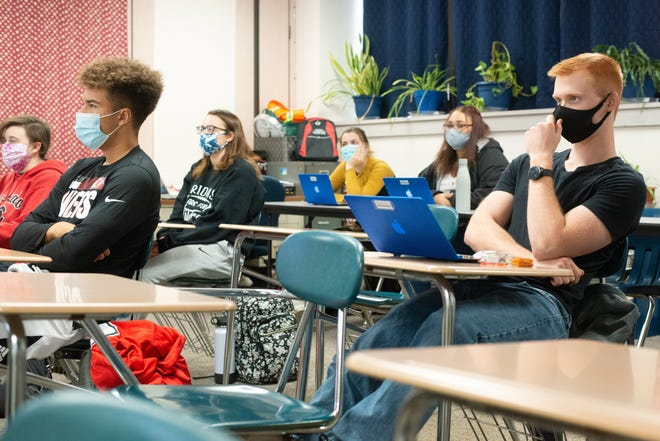 Students at Holton High School listen to their teacher during a class in November 2020. The Kansas State Department of Education, with the guidance of a group of health experts, is now recommending that as long as certain safety protocols are followed, the state's middle and high schools should reopen for continuous, in-person learning.