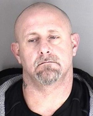 Authorities said they seized guns and methamphetamine Monday while arrested Chad D. Askins, shown here.