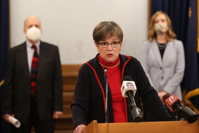 Gov. Laura Kelly announces a plan to give Kansans a tax break at a news conference Tuesday at the Statehouse. The move comes as conservatives pursue legislation of their own.