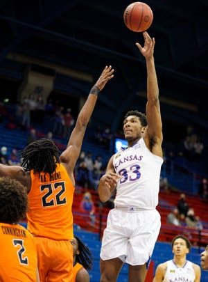 Kansas basketball's David McCormack attempts a hook shot over Oklahoma State forward Kalib Boone during Monday's game at Allen Fieldhouse in Lawrence. McCormack finished with 23 points and 10 rebounds in the Jayhawks' 78-66 victory over the No. 23 Cowboys.