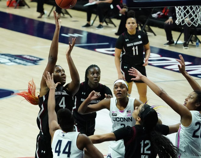 Former Worcester Academy star Aliyah Boston (4) shoots from in close for South Carolina against Connecticut in Storrs.