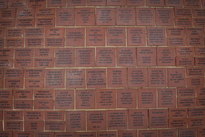 Boosters sold brick pavers to raise funds for the new stadium at Terry Sanford. The pavers are cemented beside the grandstand.