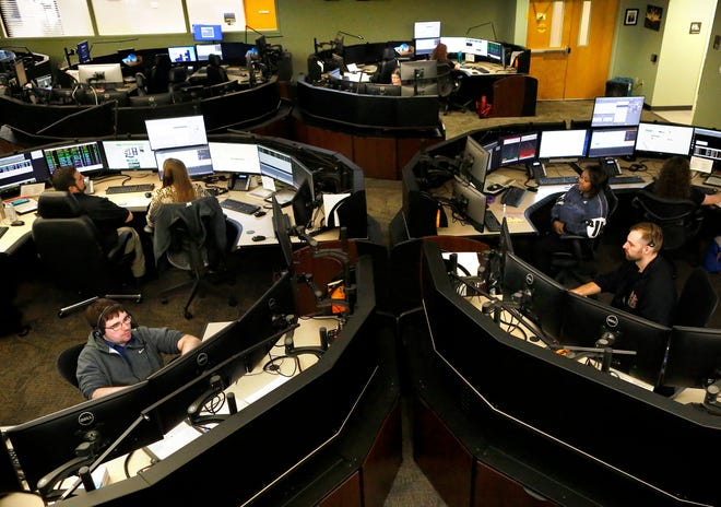 Telecommunicators at the 911 dispatch area in the Combined Communications Center answer calls at the Alachua County Sheriff's Office in Gainesville in 2020.