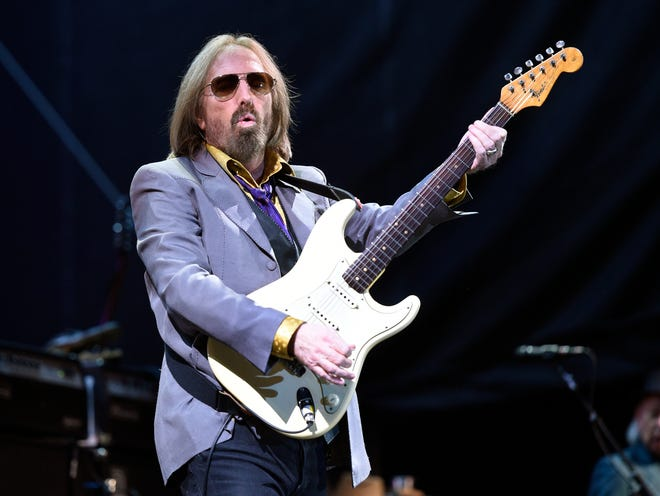 In this 2017 photo, Tom Petty performs with the Heartbreakers during their headlining set at the Arroyo Seco Music Festival in Pasadena, Calif.