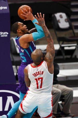 Charlotte Hornets forward P.J. Washington, top, shoots against Houston Rockets forward P.J. Tucker (17) in the first half of an NBA basketball game in Charlotte, N.C., Monday, Feb. 8, 2021. (AP Photo/Nell Redmond)