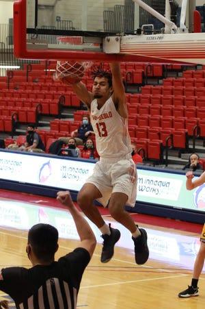 Colorado State University Pueblo freshman De'Shaun Cooper dunks during a recent game at Massari Arena. [Bill Sabo/CSU Pueblo athletics]