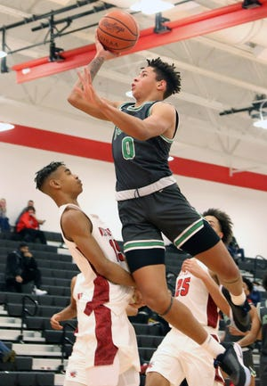 Scioto's Tysen Boze shoots over Westerville South's Reign Winston on Jan. 19. The Irish, who were 3-7 overall and 2-7 in the OCC-Capital before playing Big Walnut on Feb. 12, are seeded 36th for the Division I district tournament and will open Feb. 23 at 35th-seeded Teays Valley.