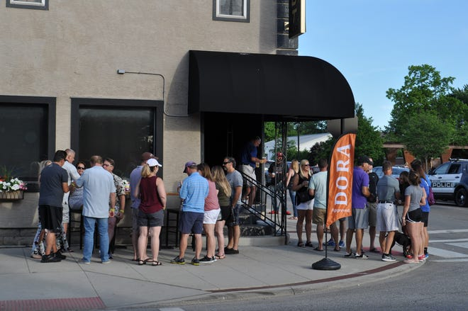 Patrons enjoy a Designated Outdoor Refreshment Area event in 2018 outside Sports on Tap in Old Hilliard. For now, because of ongoing problems at the establishment, city leaders have chosen not to include it as a DORA participant in 2021.