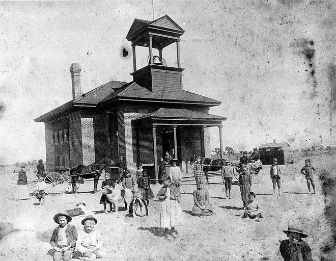 This photograph shows Pioneer Hall, the building that served as the original schoolhouse in Hesperia. The building still stands, adjacent to the Little Country Christian Church, near the corner of Main Street and C Avenue.