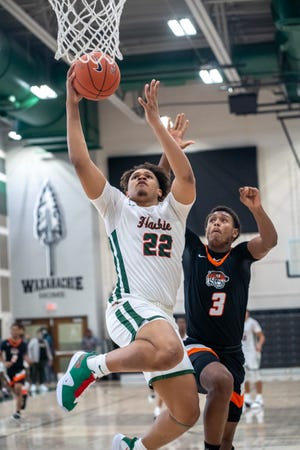 Waxahachie senior CJ Noland (22) goes in for a layup during a December home game against Lancaster. The Class 6A No. 1-ranked Runnin' Indians will come off quarantine on Wednesday and will end the regular season with four games in six days.
