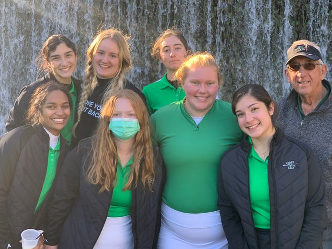 The Waxahachie girls' golf team poses with head coach Lonnie Gaylor, right, at the Marble Falls tournament this past weekend.