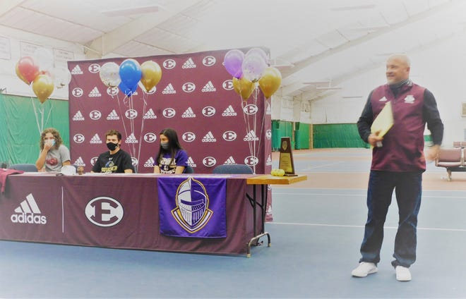 Ennis head tennis coach Keith Howard (right) addresses the crowd to announce his 3 recipients of college scholarships for 2021 during Ennis' signing day last Wednesday.