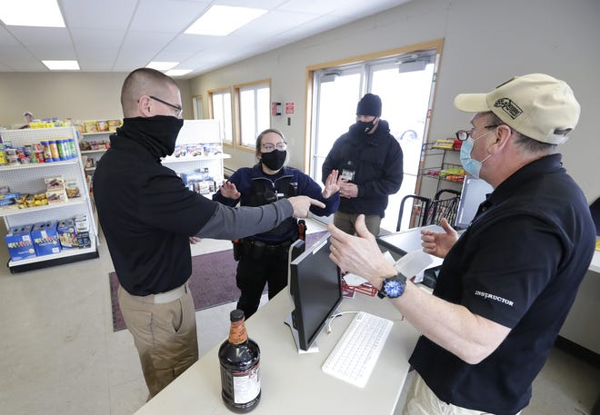 Police recruit Karolanne Johnson, center, mediates a heated situation in a convenience store during an exercise at Fox Valley Technical College's Public Safety Training Center in Greenville. Adjunct instructors Jeff Nelson, left, Todd Peters and Ty Thompson, right, conduct the scenario.
