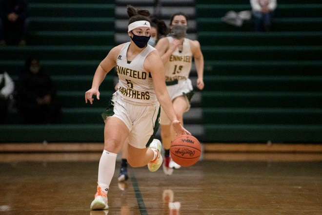 Pennfield's Abigail Schwartz (5) drives the ball on Monday, Feb. 8, 2021 at Pennfield High School. Pennfield defeated Maple Valley 50-28.