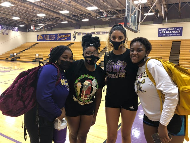 From the left, Miller's Deleiayh Mason, Esmeralda Hill, Kiarra Guzman and Serenity Simmons take a team photo after the Buccaneers defeated Calhoun to clinch a playoff berth on Monday night at the Miller High School gymnasium.