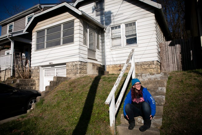 Molly B. True, 41, of Bellevue, sits on her front steps on a cold January morning. True has used harm reduction services and ultimately sought treatment. She now serves on the Harm Reduction Ohio board of directors.