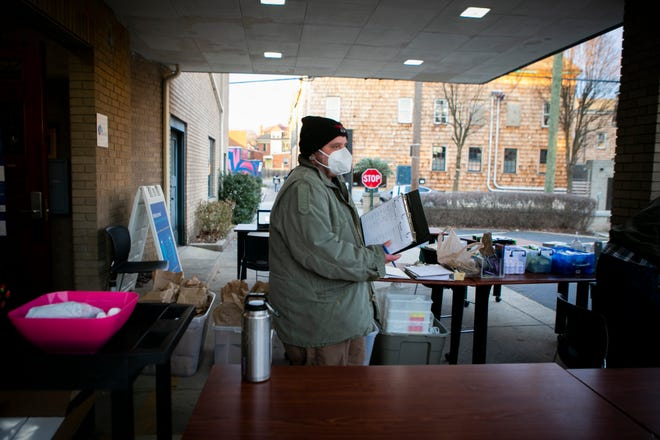 Billy Golden, a harm reduction coordinator at Caracole, in Northside, stands outside during a drive up exchange program the organization hosts weekly.