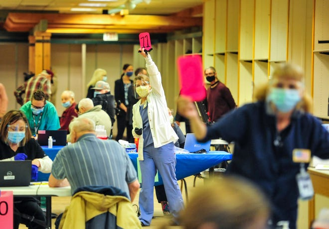 Nurses with Montana Veterans Affairs' call for their next patients during Tuesday's COVID-19 vaccination clinic at the Holiday Village Mall.  500 veterans were vaccinated in the first of four veterans clinics.