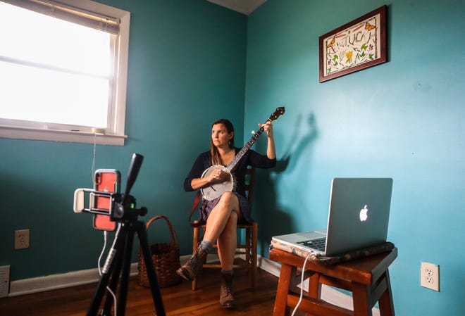 "Americana artist Carla Gover of Lexington teaches Appalachian flatfooting and clogging via livestream from her home. She also teaches Appalachian music and has been able to sign up more than 50 paying students. ""It's been an incredible windfall"" she said. Before the pandemic, she would have been making money on tour. Teaching online has helped her maintain income for expenses. Feb. 8, 2021"