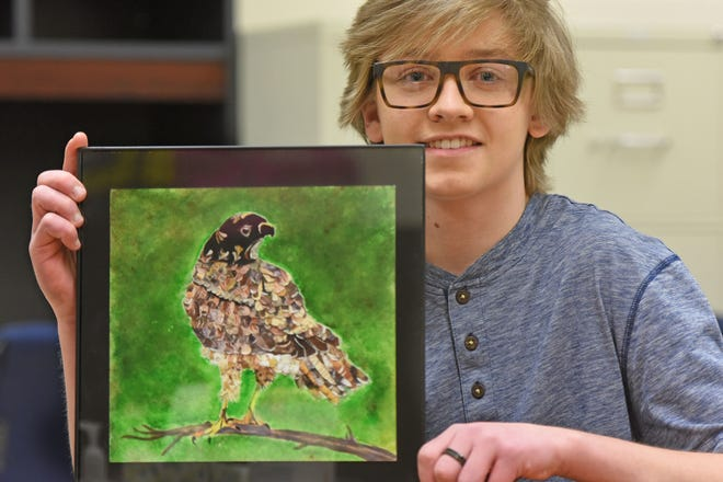 Jacob Halfhill with his collage of a Puerto Rican sharp-shinned hawk, which has been selected as a semifinalist in the Endangered Species Coalition art contest for grades 6-8.