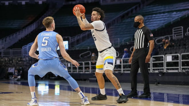 Jose Perez scored 31 points in 10 games as a junior guard at Marquette.