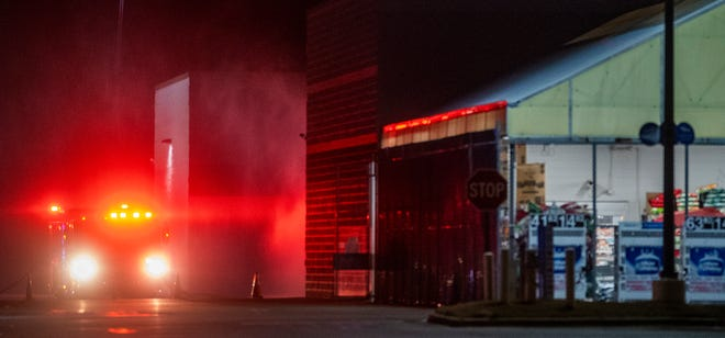 Fire and police personnel on the scene of a fire at the Walmart on Atlanta Highway in Montgomery, Ala., on Monday February 8, 2021.