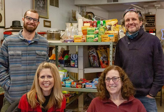 Kory Gipson and Mike Martin, owners of Common Market, and Susan Blake and and Jan Ambery of  Ambassadors for God's Creatures.
