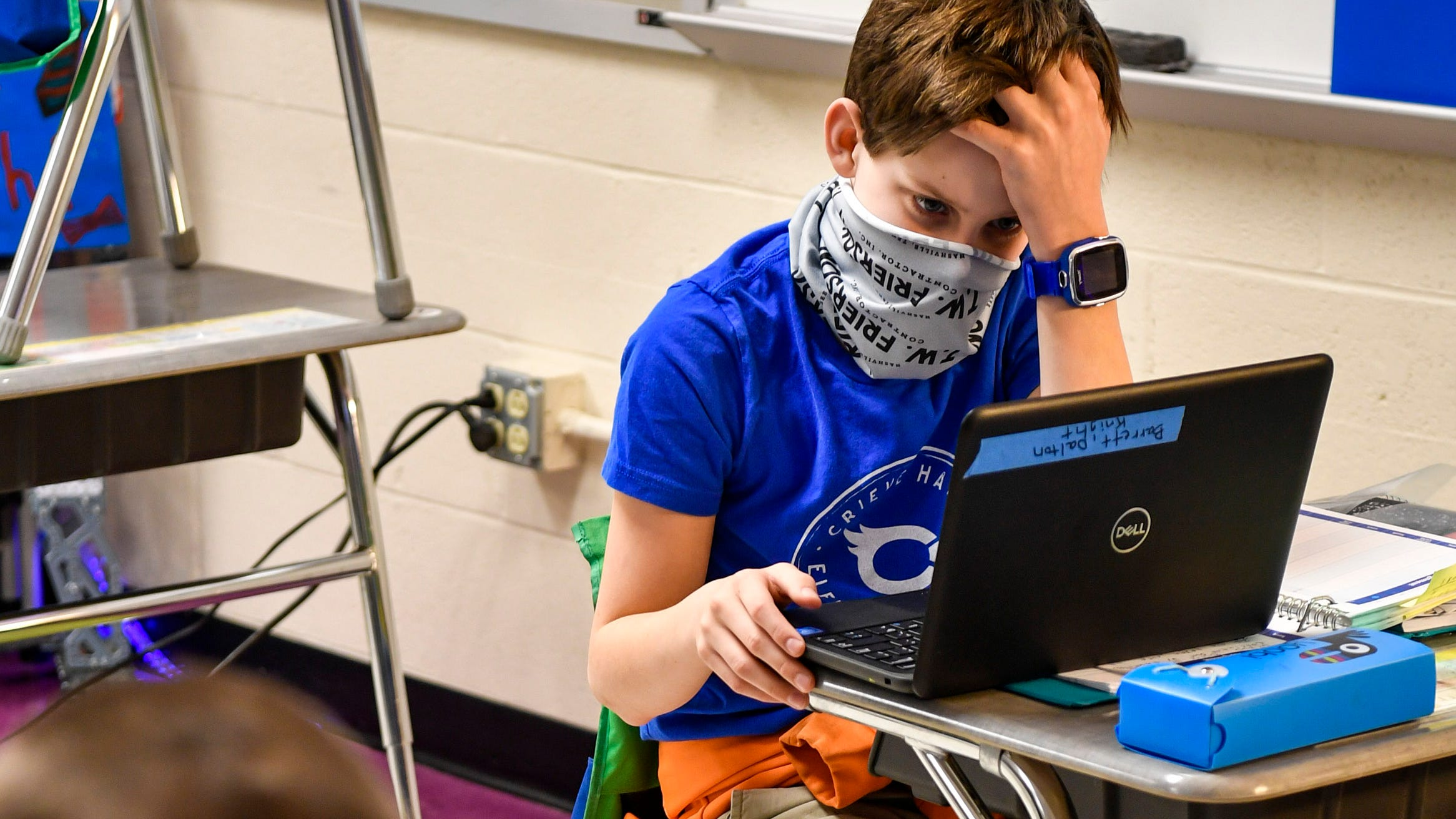Fourth-grader Barrett Dalton struggles to connect his computer to Wi-Fi on day one to return to in-person learning at Crieve Hall Elementary School on Tuesday, February 9, 2021 in Nashville, Tenn.  Kindergarten to Grade 4 and Kindergarten returned to elementary schools for in-person learning for the first time since Thanksgiving.
