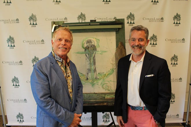 """Cypress Lake Golf Club president Scott Fischer, left, poses with artist Christopher """"CR"""" Obetz with his Patty Berg -- Anchored pop art painting unveiled Monday, Feb. 8, 2021 at the club in Fort Myers. Berg, a co-founder of the LPGA Tour, was a longtime Fort Myers resident and Cypress Lake member whose contributions were felt worldwide as well in Southwest Florida."""