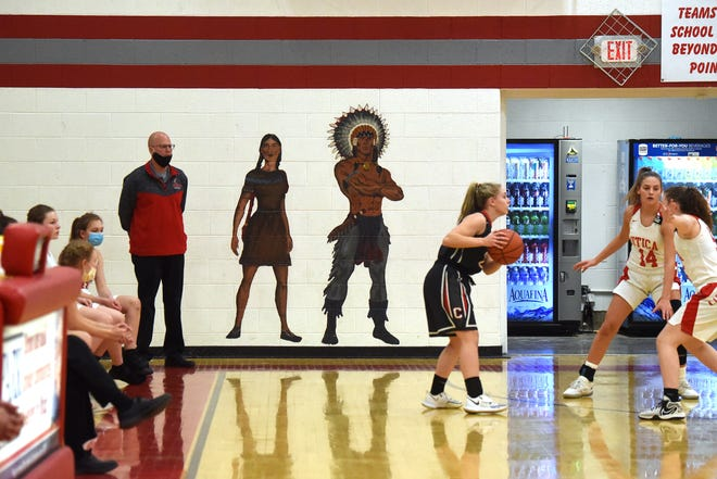 The Utica High School girls basketball team takes the court on Monday, Feb. 8, 2021 for a home game. On the far wall of the gym is a mural of a Native American woman and man. The North Fork School Board voted 5-0 against officially exploring the possibility of changing Utica's Redskins nickname.