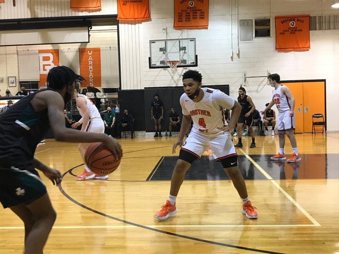 Brother Rice sophomore Xavier Thomas defends an Eastpointe player in the Warriors' first game of the 2021 season.
