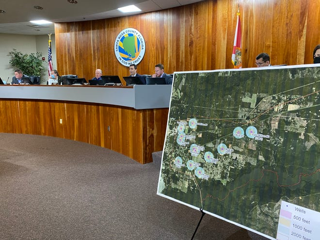 A board showing a map of borrow pits in Santa Rosa County is on display at the Feb. 9, 2020 Board of County Commissioners meeting in Santa Rosa County.