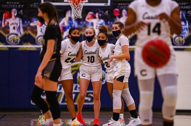Casteel girls basketball team huddles during a game
