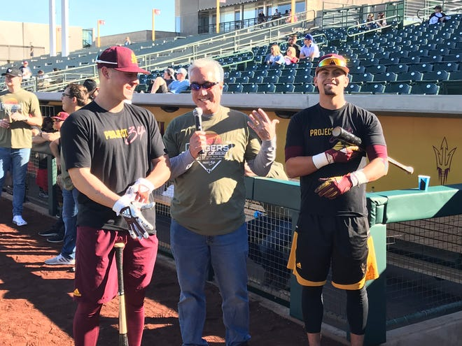 ESPN's Pedro Gomez, center, with ASU's Spencer Torkelson at a charity home run derby at Phoenix Municiipal Stadium in January 2019.